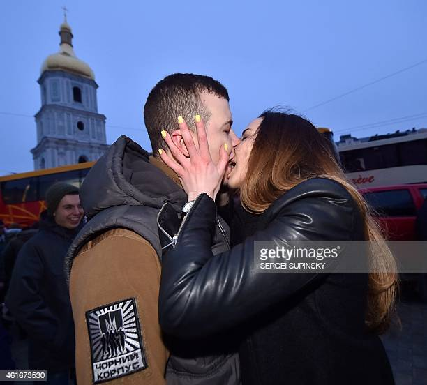 Serviceman of Azov, the Ukrainian volunteer battalion, kisses a relative during a ceremony in Kiev on January 17, 2015 before leaving to the east of...