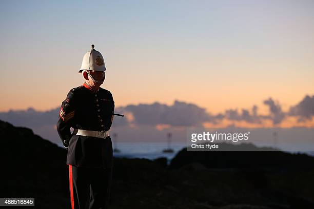 A serviceman stands guard during the ANZAC dawn service at Currumbin Surf Life Saving Club on April 25 2014 in Gold Coast Australia Veterans...