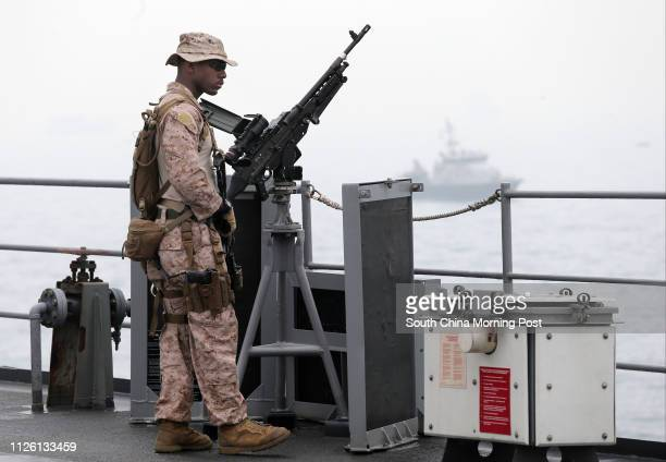 A US serviceman stands guard on the deck of USS Blue Ridge command ship of the United States Seventh Fleet that docks at Hong Kong waters The ship...