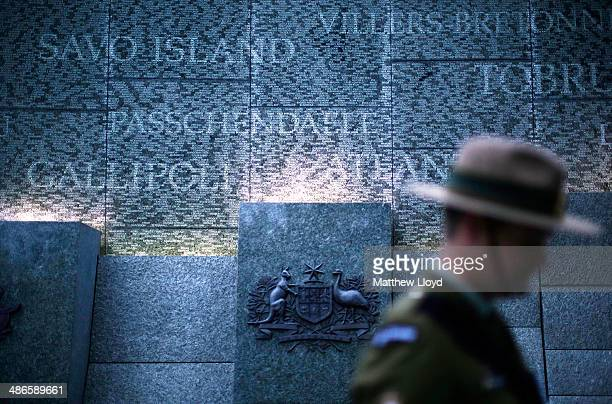 A serviceman stands in front of the Australian War Memorial during a dawn remembrance service at the Wellington Arch on ANZAC Day at Hyde Park on...