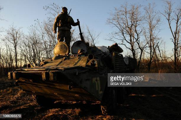 A serviceman stands on top of an APC during military drills near Urzuf village not far from the city of Mariupol eastern Ukraine on November 29 2018...