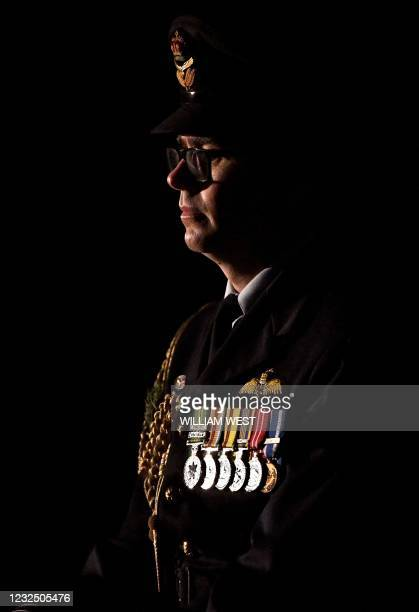 Serviceman stands to attention during an Anzac Day dawn service at the Shrine of Remembrance in Melbourne on April 25, 2021.