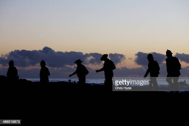 Serviceman take part in the ANZAC dawn service at Currumbin Surf Life Saving Club on April 25 2014 in Gold Coast Australia Veterans dignitaries and...