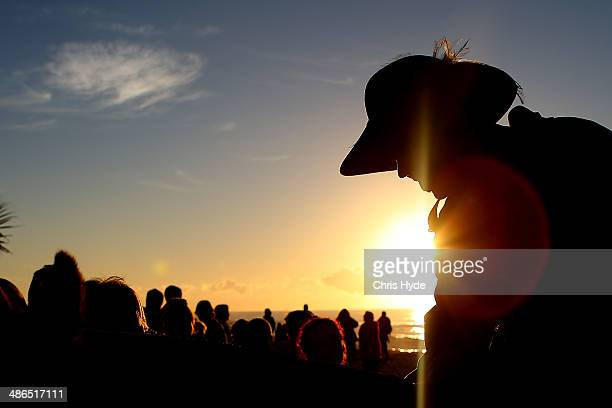 A serviceman takes part in the ANZAC dawn service at Currumbin Surf Life Saving Club on April 25 2014 in Gold Coast Australia Veterans dignitaries...