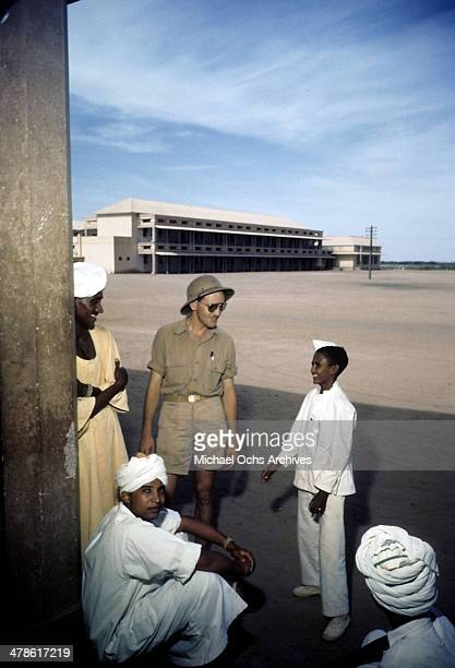 US serviceman talks with local tribesmen at the US Army Air Force/Royal Air Force base in Khartoum AngloEgyptian Sudan