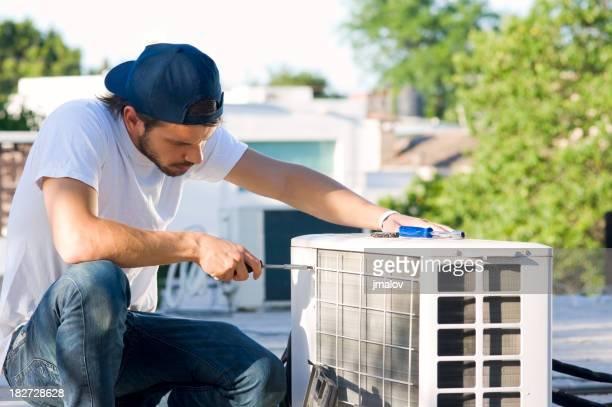 Serviceman with Heat Pump