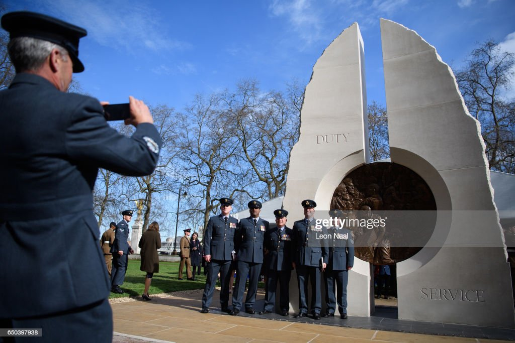 Servicemen and relatives gather around the new memorial to men and women from the UK Armed Forces and civilians who served their country in the Gulf region, Iraq and Afghanistan from 1990 - 2015, after it was unveiled by Her Majesty The Queen at Victoria Embankment Gardens on March 9, 2017 in London, England. Designed by Paul Day, the monument features two large stones, representing Iraq and Afghanistan, linked by a two-sided bronze medalion depicting the theme of duty and service.