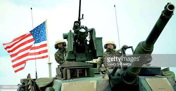 US servicemen attend an opening ceremony of the joint military exercise Noble Partner 2016 at the Vaziani training area outside Tbilisi on May 11...