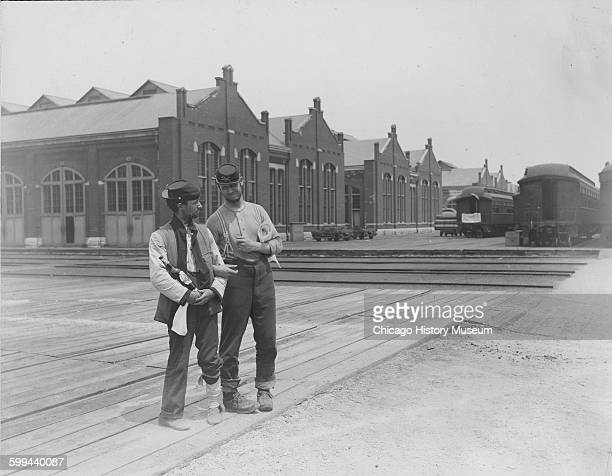 Servicemen during Pullman strike Two servicemen standing in front of a building and next to train cars during the Pullman Strike Chicago Illinois...