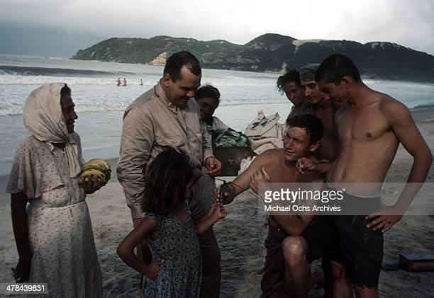 US servicemen enjoy catching seafood with locals at the beach in Natal Brazil