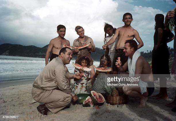US servicemen enjoy watermelons with locals at the beach in Natal Brazil