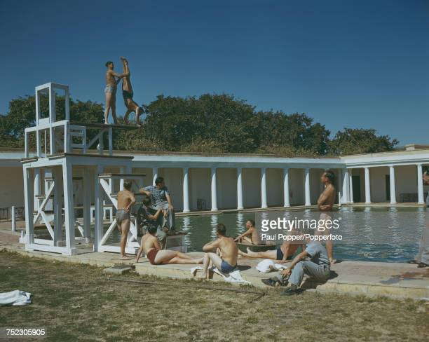 Servicemen enjoying the swimming pool at a leave camp for British troops in the grounds of Viceroy's House in New Delhi India February 1945
