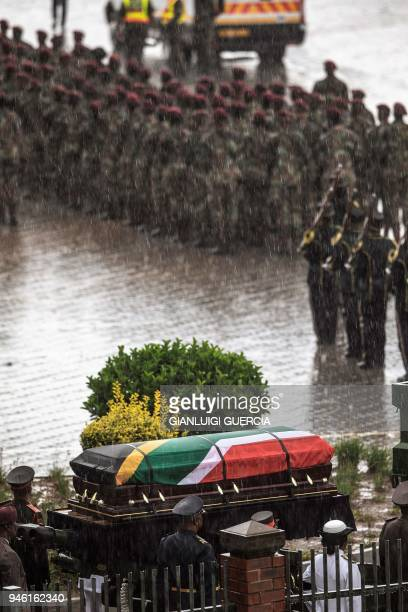 Servicemen escort the coffin containing the body of the Antiapartheid icon Winnie MadikizelaMandela at the burial site at the end of her official...