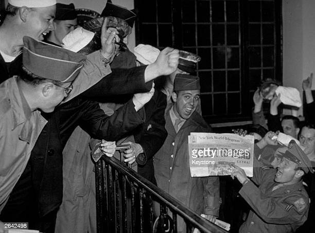 Servicemen in New York cheer the news that Hitler died in his Chancellery in Berlin