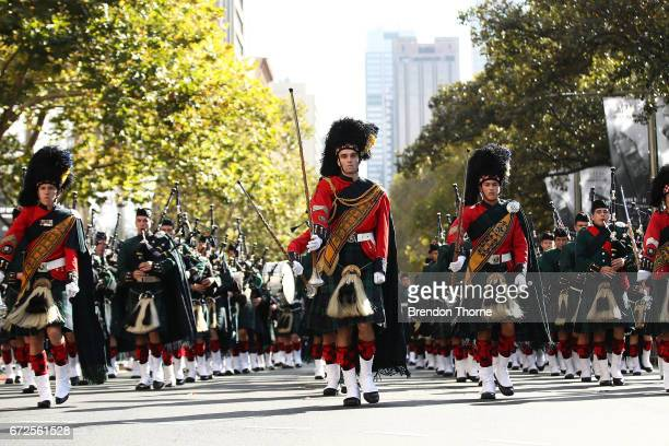 Servicemen make their way down Elizabeth Street during the ANZAC Day parade on April 25 2017 in Sydney Australia Australians commemorating 102 years...