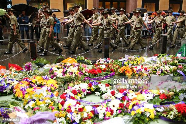 Servicemen make their way past the Cenotaph in Martin Place during the ANZAC Day parade on April 25 2014 in Sydney Australia Veterans dignitaries and...