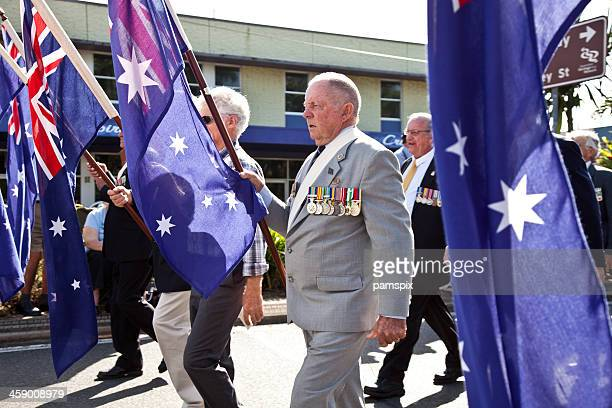 Servicemen marching on Anzac Day with Australian Flags