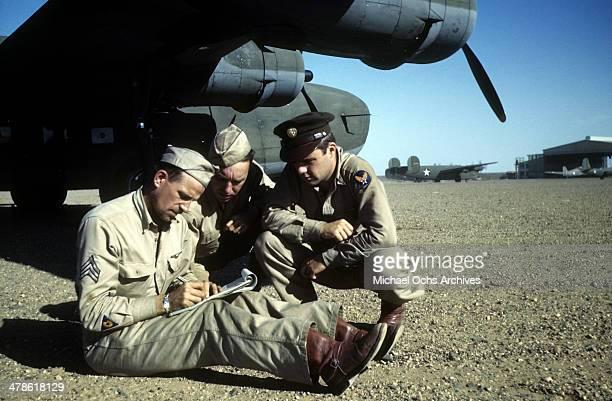US servicemen meet by a B24 Liberator plane at the Wadi Seidna air strip at the US Army Air Force/Royal Air Force base in Khartoum AngloEgyptian Sudan