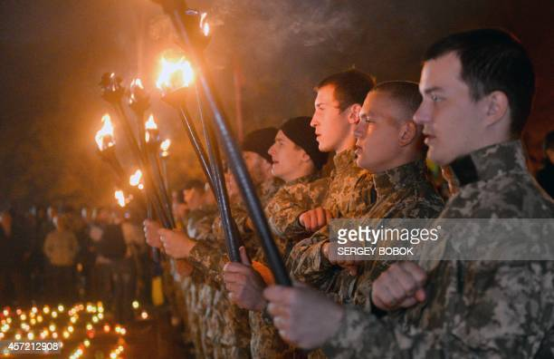 Servicemen of the Azov battalion demonstrate in Kharkiv on October 14, 2014 to mark the founding of the Ukrainian Insurgent Army , a paramilitary...