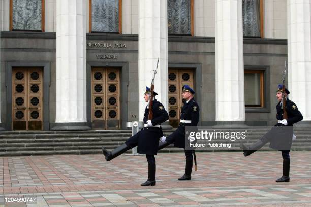 Servicemen of the National Guard perform the changing of the guard in Konstytutsii Square outside the Verkhovna Rada building during a ceremony...