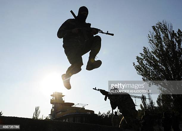 Servicemen of the proUkrainian St Maria battalion take part in military exercises near the eastern Ukrainian city of Mariupol on October 6 2014 The...