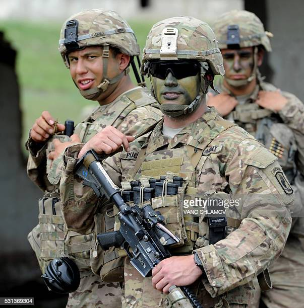 US servicemen pose for a photograph as they attend the Noble Partner 2016 joint military exercise at the Vaziani training area outside Tbilisi on May...