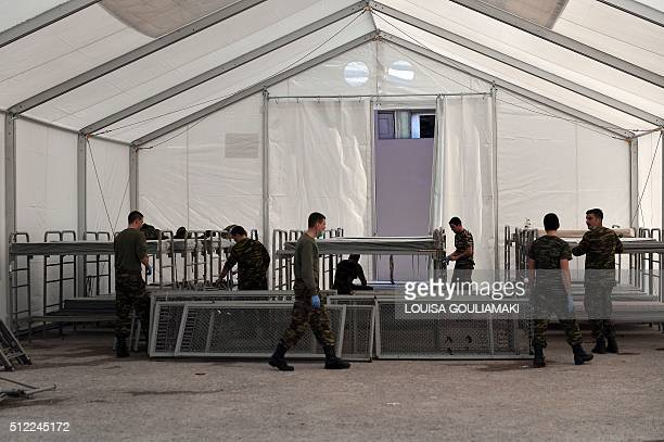 Servicemen prepare a new dormitory to host more migrants and refugees at the reception centre in Schisto near Athens where 1300 migrants mainly...