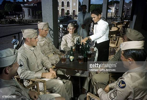 Servicemen sit to have a drink at the Grande Hotel in NATAL, BRAZIl.