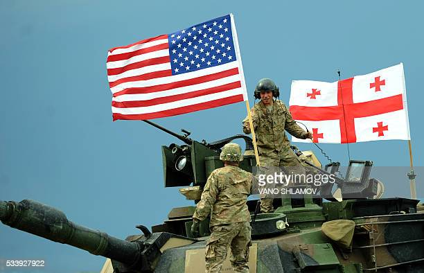US servicemen stand atop a M1A2 Abrams tank during the Noble Partner 2016 joint military exercise at the Vaziani training area outside Tbilisi on May...