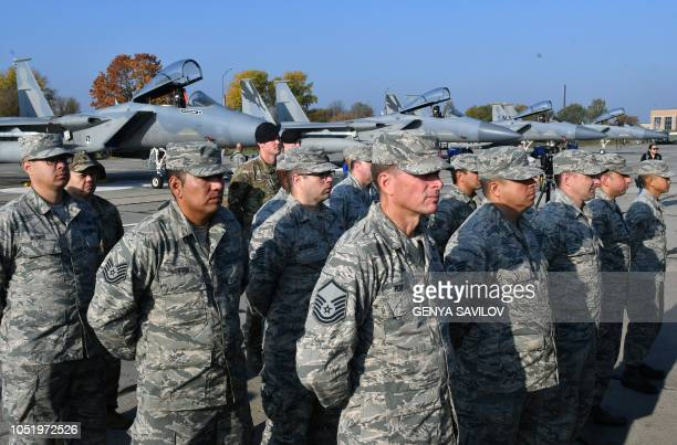 US servicemen stand in front of US F15 fighter during an air force exercise at Starokostyantyniv military airbase on October 12 2018 The largescale...