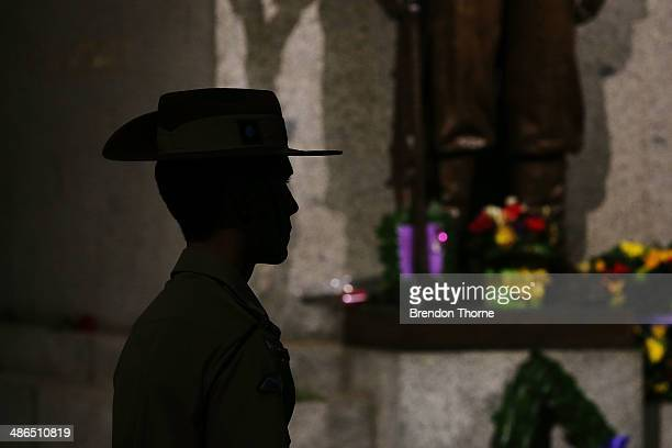 Servicemen stands in silence near the Cenotaph during the Sydney Dawn Service on April 25 2014 in Sydney Australia Veterans dignitaries and members...