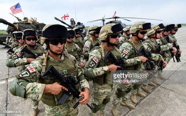 Servicemen take part in the joint multinational military exercise Noble Partner 2018 at Vaziani training centre outside Tbilisi on August 1 2018...