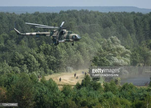 Servicemen take part in the three Swords 2021 multinational military exercise of the Lithuanian-Polish-Ukrainian Brigade at the International...