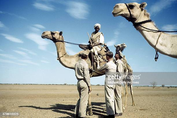 US servicemen talk with local man on a camel at the US Army and Air Force base in Khartoum AngloEgyptian Sudan