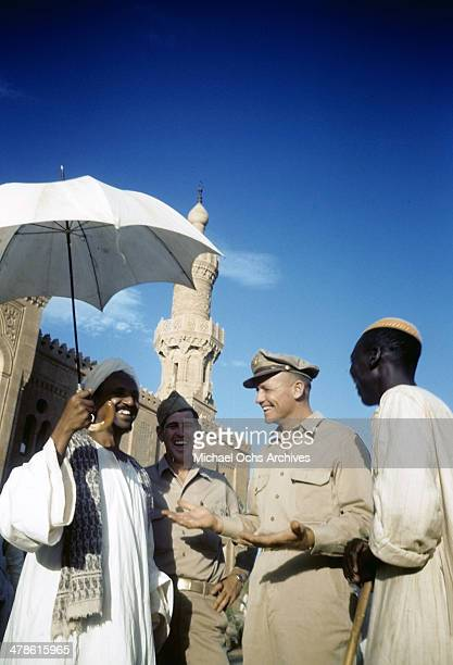 US servicemen talk with local men at the US Army and Air Force base in Khartoum AngloEgyptian Sudan