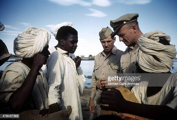 US servicemen talk with local men at the US Army and Airforce base in Khartoum AngloEgyptian Sudan