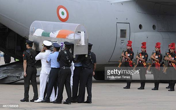 Services personnel pay homage as the mortal remains of the former President of India APJ Abdul Kalam is carried during its departure to Rameshwaram...