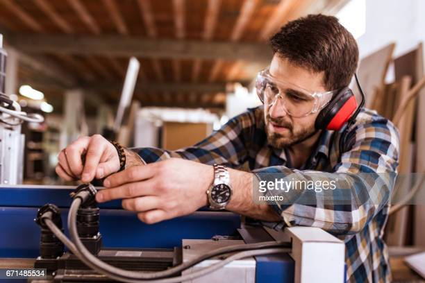 servicing cnc machines - protective eyewear stock photos and pictures