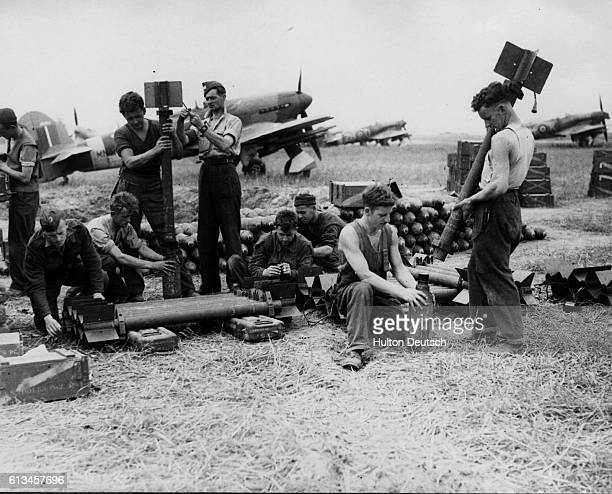 Servicing Commandos of the RAF have a busy time on the Normandy airfields assembling rocket projectiles for the Typhoons