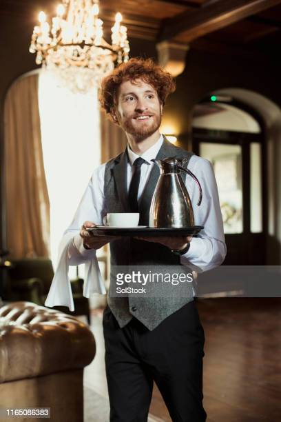 serving a cup of tea - waiter stock pictures, royalty-free photos & images