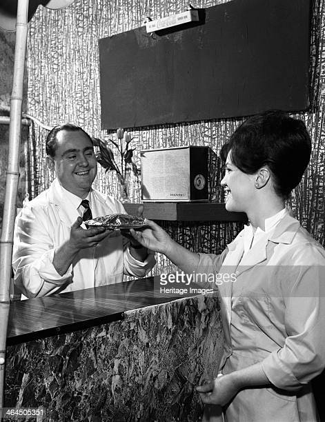 Serving a meal to a customer in a cafe Mexborough South Yorkshire 1964 Mr Vincent Mathews ran a cafe in the High Street of Mexborough in the early...