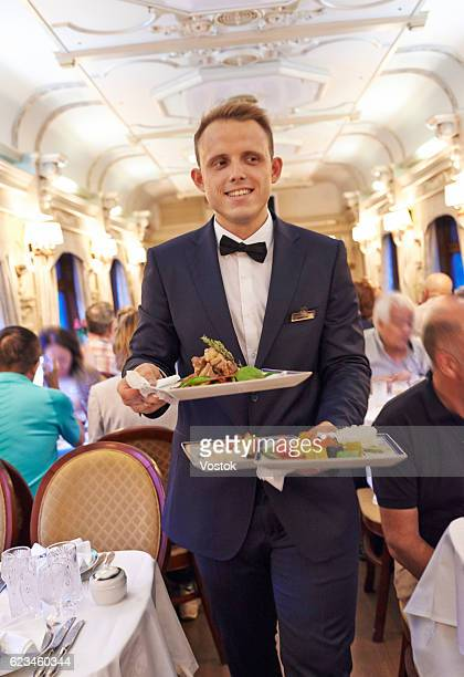 Serving dinner at the luxury train