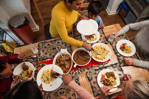 Serving Dinner to her Family 923275096