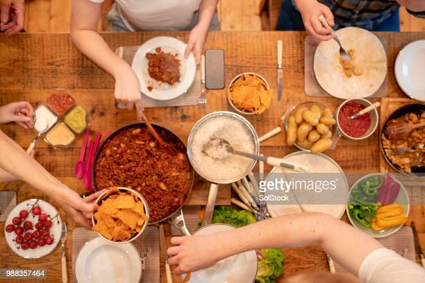 serving dinner with friends - bowl of chili stock photos and pictures