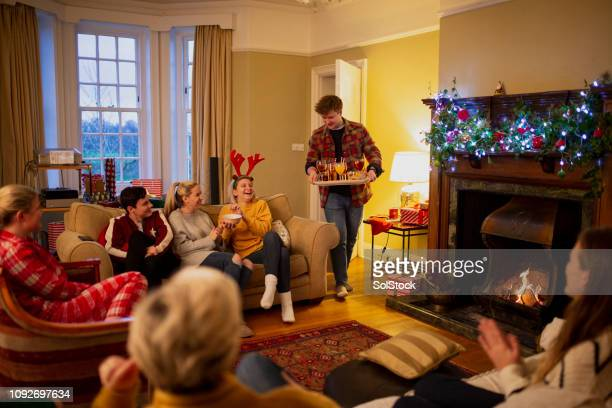serving drinks at a christmas house party - cocktail party stock pictures, royalty-free photos & images