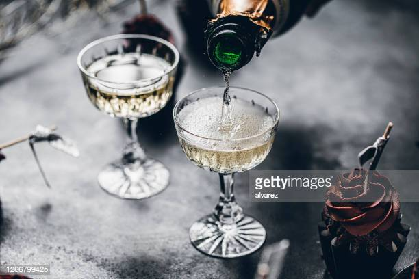 serving drinks for new years party - celebratory toast stock pictures, royalty-free photos & images