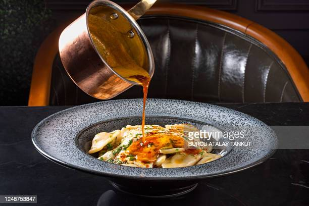 serving dumplings with butter sauce - tradition stock pictures, royalty-free photos & images
