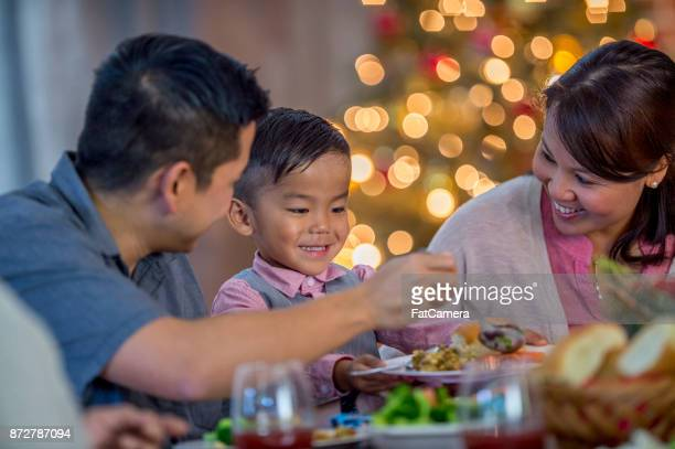 serving food - filipino family dinner stock pictures, royalty-free photos & images