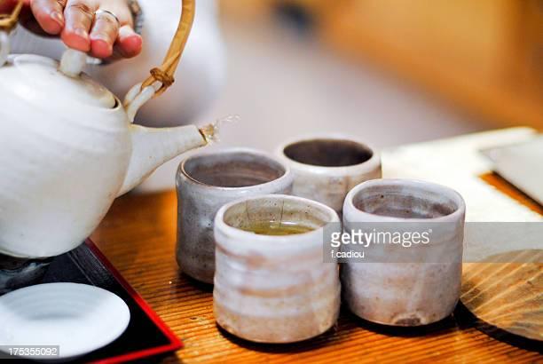 serving green tea - ティーポット ストックフォトと画像