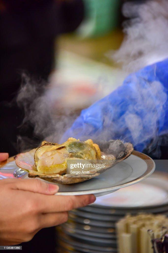 Serving Hokkaido grilled scallop : Stock Photo